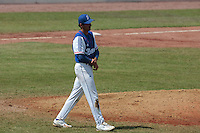 30 july 2010: Starting pitcher Samuel Meurant is in pain after being hit in the arm by a ball during Sweden 3-2 win over France, in day 6 of the 2010 European Championship Seniors, at TV Cannstatt ballpark, in Stuttgart, Germany.