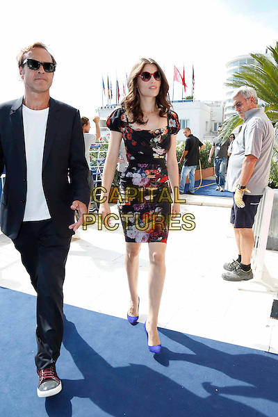Laetitia Casta.Venice Film Festival, Italy..August 29th, 2012.full length black dress red purple pink floral print dress sunglasses shades .CAP/IPP.©IPP/Capital Pictures.