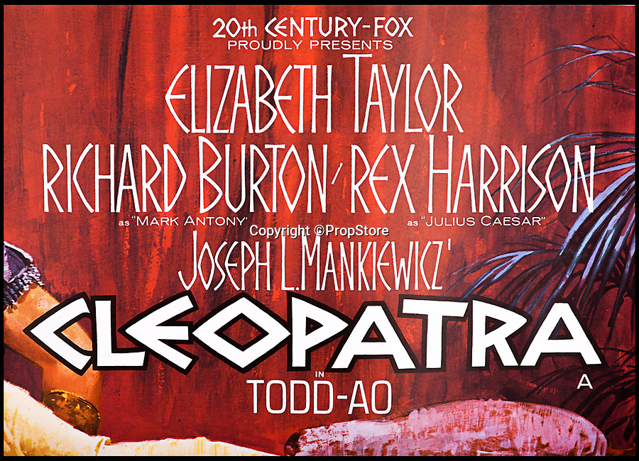 BNPS.co.uk (01202 558833)<br /> Pic:   PropStore/BNPS<br /> <br /> The poster for the original Taylor/Burton blockbuster film Cleopatra - now worth half as much as the Carry On classic.<br /> <br /> What a Carry On...banned poster set to sell for £3000.<br /> <br /> An incredibly rare movie poster from the slapstick classic Carry On Cleo has finally had the last laugh, 55 years after it was banned from use.<br /> <br /> It's now twice as valuable to movie buffs as the original Cleopatra poster starring Richard Burton and Elizabeth Taylor that it attempted to lampoon.<br /> <br /> The artwork for the 1964 comedy classic had to be binned after movie bosses of the far more expensive Taylor/Burton film from the previous year had complained about blatant copyright abuse.<br /> <br /> The poster for the original 1963 epic showed Taylor as Cleopatra sprawled on a bed with Burton's Mark Anthony stood over her.<br /> <br /> The tongue-in-cheek Carry On version featured a winking Amanda Barrie and a leering Sid James  stood behind her. <br /> <br /> The Prop Store are also selling an original Cleopatra poster in the same sale with a estimate of £1500...only half the value of the Carry On version.