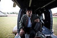 Oruro, Bolivia<br /> A picture dated January 12, 2015 shows Bolivianf President Evo Morales eating some dry meat in his helicopter in his home town of Orinoca.