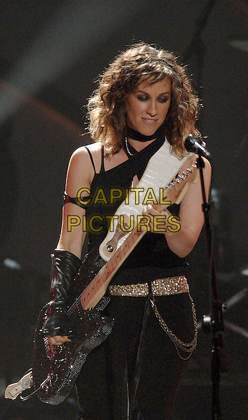 ALANIS MORISSETTE.Performs at The World Music Awards-Show held at the Kodak Theatre,.Hollywood, 31st  August 2005.half length stage gig concert black top guitar .www.capitalpictures.com.sales@capitalpictures.com.© Capital Pictures.