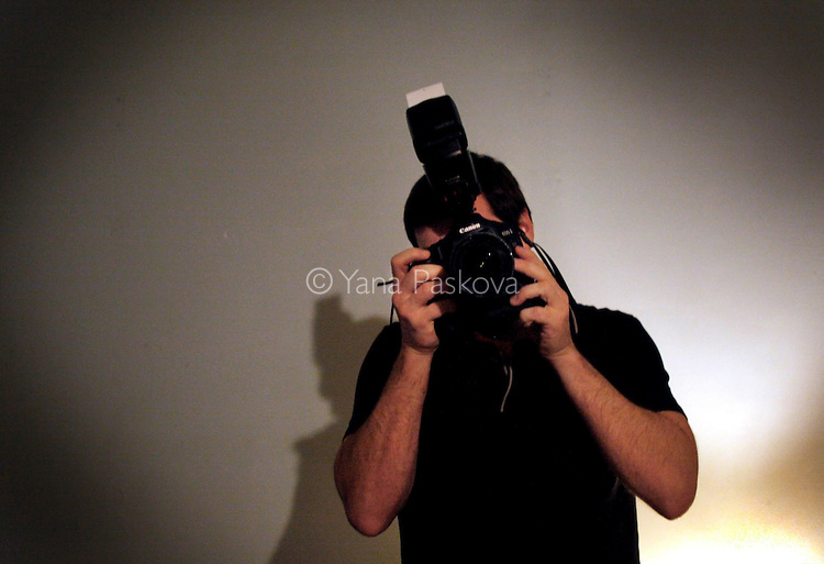 Chris Hondros behind the camera at his loft apartment on Tillary St. in Brooklyn, New York, March 21, 2008...© Yana Paskova 2011