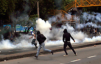 MEDELLIN, COLOMBIA - OCTOBER 24 Students clash with members of the Mobile Anti-Disturbance Squadron (ESMAD), during a protest in Medellin, Colombia, on October 24, 2019. Regional elections will take place on October 27 in Colombia. (Photo by Fredy Builes/VIEWpress)