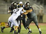Torrance, CA 09/19/15 - Thomas Craig (Torrance #60) and James Kozachenko (Peninsula #42) in action during the Peninsula Panthers - Torrance Tartars Varsity football game at Torrance High School