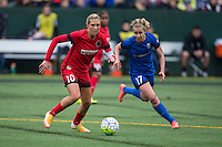 Seattle, Washington - Saturday May 14, 2016: Portland Thorns FC midfielder Allie Long (10) is marked by Seattle Reign FC midfielder Beverly Yanez (17) during the first half of a match at Memorial Stadium on Saturday May 14, 2016 in Seattle, Washington. The match ended in a 1-1 draw