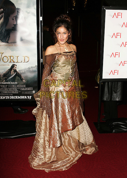 "Q'ORIANKA KILCHER.""The New World"" Los Angeles Premiere to Benefit the American Film Institute held at the Academy of Motion Pictures Arts and Sciences, Beverly Hills, California. .December 15th, 2005.Photo: William Scott/AdMedia/Capital Pictures.Ref: WS/ADM.full length brown sheer sleeves shimmery metallicc dress off the shoulder.www.capitalpictures.com.sales@capitalpictures.com.© Capital Pictures."