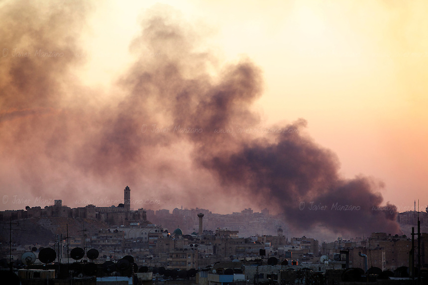 Smoke rises near the historical Old City of Aleppo after a fighter jet dropped two bombs apparently targeting fighting positions in this heavily populated suburb of Aleppo. September 25, 2012...© Javier Manzano