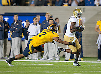 October 6th, 2012: UCLA's Jerry Johnson tries to avoid California's Jalen Jefferson's Tackle during a game at Memorial Stadium, Berkeley, Ca    California defeated UCLA 43 - 17