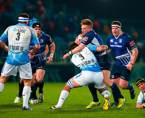 23.03.2013 Dublin, Ireland. Ian Madigan (Leinster) runs in to a tackle from Josh Strauss (Glasgow) during the RaboDirect Pro12 game between Leinster and Glasgow from the RDS Arena.