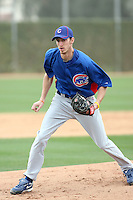 Kyle Smit #78 of the Chicago Cubs participates in pitchers fielding practice during spring training workouts at the Cubs complex on February 19, 2011  in Mesa, Arizona. .Photo by Bill Mitchell / Four Seam Images.