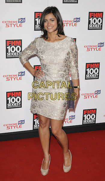 LUCY VERASAMY.The FHM 100 Sexiest Women for 2011 party, One Marylebone Rd., London, England..May 4th, 2011.full length silver white lace sheer dress hand on hip black clutch bag.CAP/CAN.©Can Nguyen/Capital Pictures.