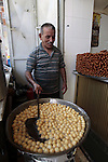 A Palestinian man prepares traditional sweets during the first day of the holy fasting month of Ramadan, in the West Bank city on Nablus on July 10, 2013. Photo by Nedal Eshtayah