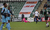 Alex Lynch of Wycombe Wanderers lies injured during the Sky Bet League 2 match between Plymouth Argyle and Wycombe Wanderers at Home Park, Plymouth, England on 30 January 2016. Photo by Mark  Hawkins / PRiME Media Images.