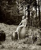 JAPAN, Kyushu, portrait of Jinembo a master potter sitting on a pot (B&W)