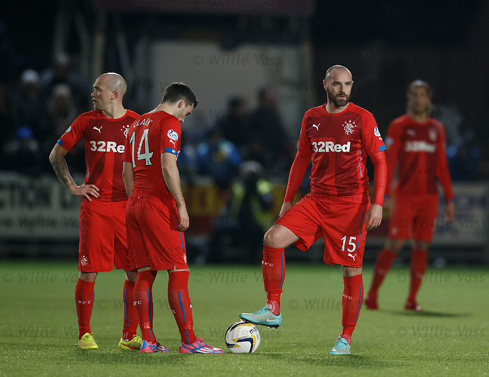 Rangers players stand dejected after the second queens goal