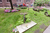 """A large tour group visits Trinity Church's cemetery in the Financial District of New York on Thursday, June 16, 2016. Because of the success of the musical """"Hamilton"""" on Broadway sites associated with Alexander Hamlton have seen an increase in interest and tourist traffic. (©Richard B. Levine)"""