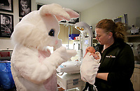 NWA Democrat-Gazette/DAVID GOTTSCHALK Christi Roderique, director of women's and children's department at Mercy Hospital Northwest Arkansas, introduces her grandson Easton South, 2 days old, Wednesday, March 28, 2018, to the Easter Bunny inside the Neonatal Intensive Care Unit at the hospital in Rogers. The Benton County Sheriff's Department partnered with the Easter Bunny Foundation and visited with and gave away stuffed animal bunnies to hospitalized children. This is the second year the department has participated in the program and will also be visiting the Northwest Arkansas Children's Shelter and Arkansas Children's Northwest.