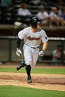 Birmingham Barons right fielder Ryan Brett (15) runs to first base during a game against the Pensacola Blue Wahoos on May 8, 2018 at Regions FIeld in Birmingham, Alabama.  Birmingham defeated Pensacola 5-2.  (Mike Janes/Four Seam Images)