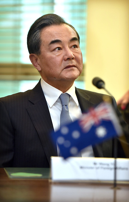 Chinese Foreign Minister Wang Yi listens to Australian Foreign Minister Julie Bishop during the Australia-China Foreign and Strategic Dialogue at Parliament House Canberra, Tuesday Feb 7, 2017. AFP PHOTO/ MARK GRAHAM