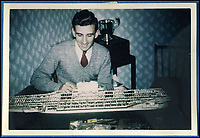 BNPS.co.uk (01202 558833)Pic: PhilipWarren/BNPS<br /> <br /> Philip Warren building USS Forrestal in 1956.<br /> <br /> Master modeller Philip Warren has spent 70 years building an incredible fleet of 484 warships and he says he is not ready to sail into the sunset.<br /> <br /> Philip, 87, has dedicated his entire adult life to crafting the matchstick armada and has built every class of ship in the Royal Navy since 1945, using over a million matchsticks.<br /> <br /> He recently completed a magnificent 3ft replica of the HMS Queen Elizabeth aircraft carrier which took him eight months.
