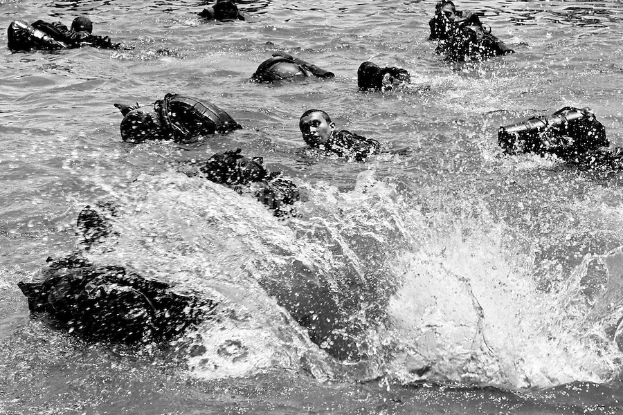 Young Colombian recruits swimm in the water to practise jungle survival, 23 September 2006, Meta Department, Colombia.