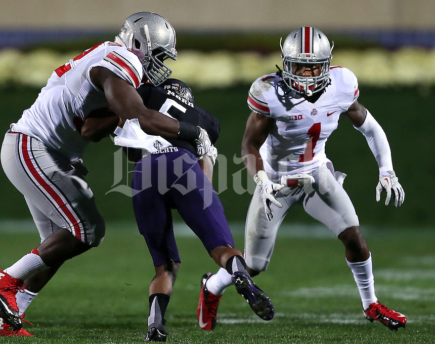 Ohio State Buckeyes defensive lineman Adolphus Washington (92) and Ohio State Buckeyes cornerback Bradley Roby (1) converge on Northwestern Wildcats running back Venric Mark (5) during the first half of the NCAA football game between Ohio State and Northwestern at Ryan Field in Evanston, Illinois on Saturday, October 5, 2013. (Columbus Dispatch photo by Jonathan Quilter)