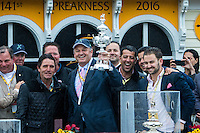 BALTIMORE, MD - MAY 21: Exaggerator owner Matt Bryan (C) holds the trophy as he stands with trainer Keith Desormeaux (L) and connections after winning the 141st running of the Preakness Stakes at Pimlico Race Course on May 21, 2016 in Baltimore, Maryland. (Photo by Sue Kawczynski/Eclipse Sportswire/Getty Images)