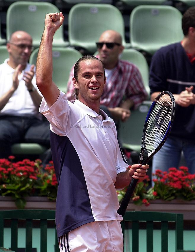 Photo. Richard Lane. .Roland Garros 2002, French Open Tennis. 29/5/2002.Xavier Malisse of Belgium celebrates victory over Tim Henman.