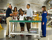Terry White, United Space Alliance project lead for thermal protection systems, left, shows United States President Barack Obama and his family, from left, First Lady Michelle Obama, Malia, Marian Robinson and Sasha, how tiles work on the space shuttle during their visit to the Orbital Processing Facility at the NASA Kennedy Space Center in Cape Canaveral, Florida, Friday, April 29, 2011. Looking on is Director of Flight Crew Operations for the Johnson Space Center and Astronaut, Janet Kavandi..Mandatory Credit: Bill Ingalls / NASA via CNP