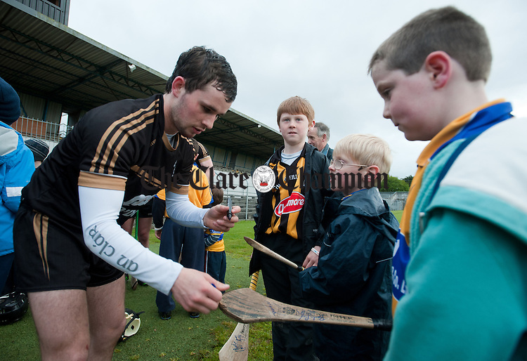 Clare senior hurler Cathal O Connell signs autographs for Seadhna Liddy, Jonah  Liddy and Mark Kelly during the Clare GAA Open Night as part of the national  launch of this years Championship. Photograph by John Kelly.