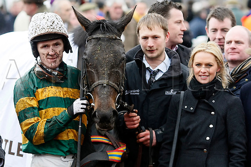 15.03.2013 Cheltenham, England. At Fishers Cross ridden by AP McCoy enters the winners enclosure after winning in the Albert Bartlett Novices Hurdle on day Four (Gold Cup Day) of the Cheltenham National Hunt Festival.