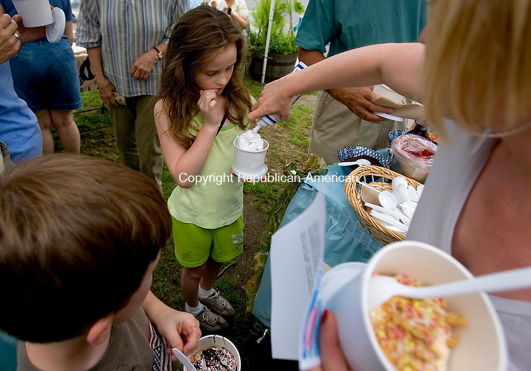 WOODBURY, CT --JUNE 27, 2008-062708JS06-Kaleigh Comerford, 8, of Watertown, center, gets whipped cream put on her ice cream by her aunt Sue Butkus of Naugatuck, right, while Michael Comerford, 7, left, waits for some, during the annual ice cream social to benefit Safe Haven of Greater Waterbury held Friday at New Morning Natural and Organic Store in Woodbury. Safe Haven is a free emergency shelter for victims of domestic violence.<br /> Jim Shannon/Republican-American