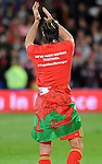 UEFA EURO 2016 Qualifier match between Wales and Andorra at Cardiff City Stadium in Cardiff : Gareth Bale celebrating at full time wrapped in Welsh Flag.