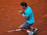 France, Paris, 08.06.2014. Tennis, French Open, Roland Garros, Final men: Rafael Nadal (ESP) fals to his knees after defeating Novak Djokovic (SRB)<br /> Photo:Tennisimages/Henk Koster