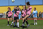 London, UK on Sunday 31st August, 2014. Match action from the PowPow Girls team (pink) v Amy Child's (right) team during the Soccer Six charity celebrity football tournament at Mile End Stadium, London.