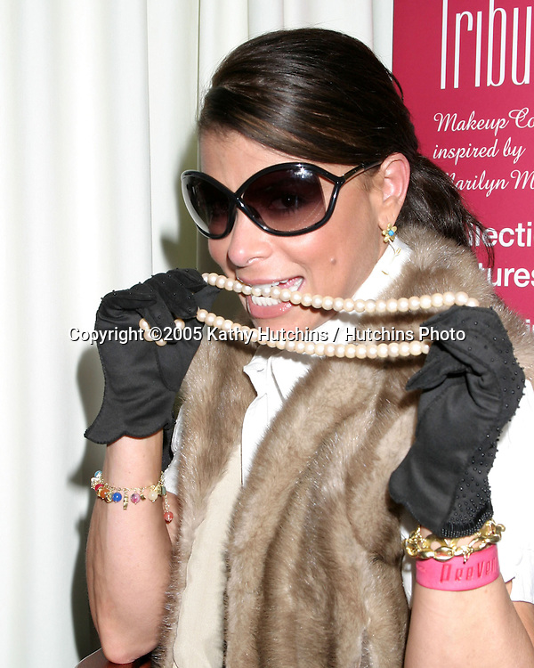 Paula Abdul .wearing fur vest, gloves, and pearls previously owned by Marilyn Monroe.  They are currently .owned by Mill Conroy who  is one of the founders of Bodyography.  His aunt was Inez Melson, Marilyn Monroe's business manager.  Mill inherited one of the largest collections of personally owned items of Marilyn Monroe.  He is creating a cosmetic brand with Dena Wiseman that is inspired by this collection and will mirror Marilyn's complete beauty look..GBK Productions Emmy Gifting Lounge.Sofitel Hotel.August 23, 2006.©2006 Kathy Hutchins / Hutchins Photo....