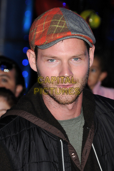 "Brian Guest.""The Thing"" World Premiere held at AMC Citywalk Stadium 19, Universal City, California, USA..October 10th, 2011.headshot portrait black red grey gray flat cap plaid tartan hat stubble facial hair .CAP/ADM/BP.©Byron Purvis/AdMedia/Capital Pictures."