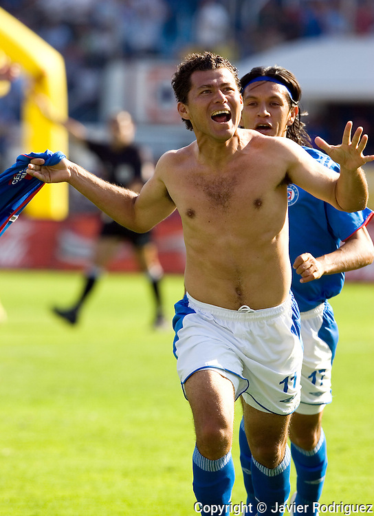 Cruz Azul forward Miguel Sabah celebrates his goal against America Aguilas as his teamate Alejandro Corona runs behind him during their soccer match at the Azul Stadium in Mexico City, April 15, 2006. America won 3-1 to Cruz Azul. Photo by © Javier Rodriguez