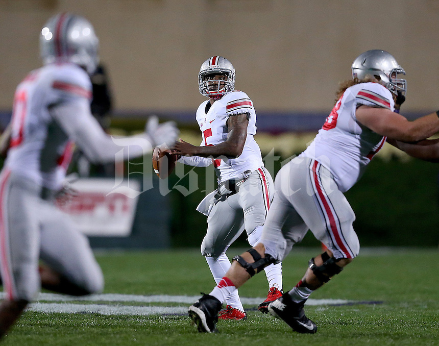 Ohio State Buckeyes quarterback Braxton Miller (5) looks for someone to throw to during the first half of the NCAA football game between Ohio State and Northwestern at Ryan Field in Evanston, Illinois on Saturday, October 5, 2013. (Columbus Dispatch photo by Jonathan Quilter)
