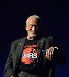 Garden City, New York, USA. October 23, 2015. Former NASA astronaut Edwin BUZZ ALDRIN smiles as he gestures with his left hand during conversation about his early years, experiences in space, and his new Children's Middle Grade book Welcome to Mars: Making a Home on the Red Planet. After the talk at the jetBlue Sky Theater Planetarium at Long Island's Cradle of Aviation Museum, Aldrin signed copies of his new book. Aldrin is wearing his Destination MARS shirt. On the 1969 Apollo 11 mission, Buzz Aldrin was the second person ever to walk on the Moon, and his first trip to space was the 1966 Gemini 12.