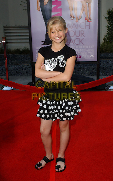 JENNA BOYD.Attends the world premiere of Mean Girls at the Cinerama Dome, Hollywood, California..April 19th 2004.fringe black and white t-shirt ponytail polka dot ruffle ra ra skirt flip flops sandals full length full-length.*UK sales only*.www.capitalpictures.com.sales@capitalpictures.com.©Capital Pictures
