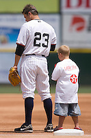 Andy Phillips #23 of the Charlotte Knights and a young fan bow their heads during the National Anthem at Knights Castle May 3, 2009 in Fort Mill, South Carolina. (Photo by Brian Westerholt / Four Seam Images)
