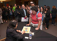 Jasmine Tovar '14 meets longtime labor leader Dolores Huerta, 81, after she spoke at Occidental College's Thorne Hall on March 25, 2014.<br /> (Photo by Marc Campos, Occidental College Photographer)
