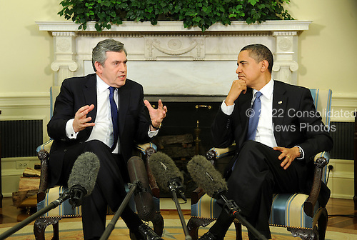 Washington, DC - March 3, 2009 -- United States President Barack Obama (R) listens as Prime Minister Gordon Brown of Great Britain delivers remarks following a meeting in the Oval Office at the White House in Washington on Tuesday, March 3, 2009..Credit: Kevin Dietsch / Pool via CNP
