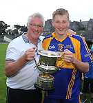 13-08-2014 : Pat Spillane, manager of the Kenmare District  team celebrates with his son Pat Spillane junior after winning the  Kerry U-21 football Championship final at Fitzgerald Stadium, Killarney,  on Wednesday night. Picture: Eamonn Keogh (MacMonagle, Killarney)