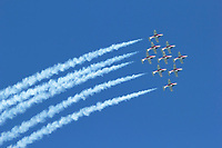 Nine CT-114 Tutor jets of the Canadian Snowbirds pass overhead in a diamond formation. The Snowbirds are part of the 431 Air Demonstration Squadron and are based out of Moose Jaw, Saskatchewan.The team has flown the Canadian built CT-114 Tutor jet since 1971.
