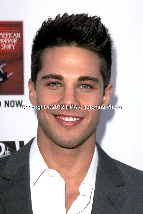 """LOS ANGELES - OCT 13:  Dean Geyer arrives at the """"American Horror Story: Asylum"""" Premiere Screening at Paramount Theater on October 13, 2012 in Los Angeles, CA"""