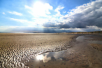 Popular south coast resort Camber Sands looks at it's best in the sunshine of early September. The tide goes out a long way leaving rock pools for children to play in, but the miles of sand dunes are it's big attraction. Camber Sands, East Sussex, September 4th 2020<br /> <br /> Photo by Keith Mayhew