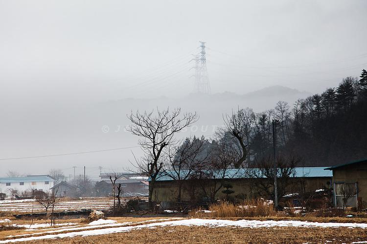 Tamura, February 23 2012 - Electricity poles coming from Fukushima Daiichi nuclear power plants.