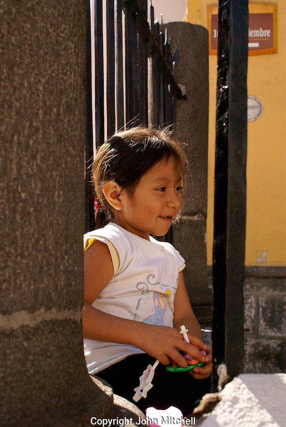 Young Mexican girl  in the city of Puebla, Mexico. The historical center of Puebla is a UNESCO World Heritage Site..